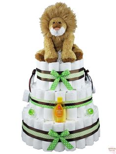"Leo the Lion Diaper Cake - Meet the king of the diaper cake jungle!  The plush lion on top of this cake will make for a ""roaring"" good time at the baby shower and the new parents will love the diapers and various baby items that decorate the exterior.  Pounce on this diaper cake today and it will be cat's meow of the gifts at the shower (we are not 'lion')! -   Price:  $110 -   http://www.rattlecake.com/diaper-cakes/leo-the-lion-diaper-cake-3-tier.html"