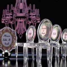 Very cool miniature Ghost Chair Escort Cards.  Now where do you find them?