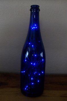Blue wine bottle light with blue lights. by DesignsbyKKay on Etsy, $20.00