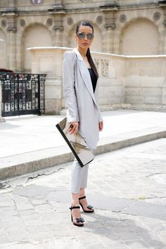"""Ethel Chalopin, mum  """"I'm wearing an Ann Demeulemeester suit with Chanel sunglasses, a Maison Martin Margiela bag and Christian Louboutin shoes."""" Photo By Dvora"""