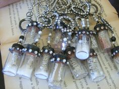 """used glass bottles 1 1/4"""" tall and filled with glitter."""