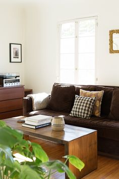 brown sofa and simple wood coffee table / sfgirlbybay
