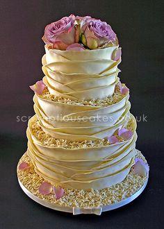 Wedding Cake (494) - 3 tier round wedding cake in my original signature white chocolate wrap style with fresh dusky pink roses, chocolate shavings and ivory ribbon.