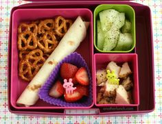 They use silicone cupcake moulds!  Laptop Lunches 2.0 with Bento Buddies, via Flickr.