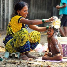 Mother bathing her child.