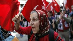 A woman shouts slogans during a protest near Taksim Square in Istanbul on 6 June 2013