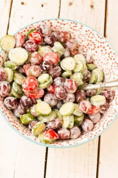 The perfect Memorial Day side! cucumber grape salad with strawberry poppy seed dressing! ohsweetbasil.com