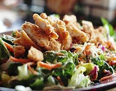 Applebee's Oriental Chicken Salad My dressing recipe calls for 12T honey, 6 T rice wine vinegar, 1 cup mayo, 4 tsp Dijon mustard and 1/2 tsp sesame oil.  It makes a lot but we always use it up.