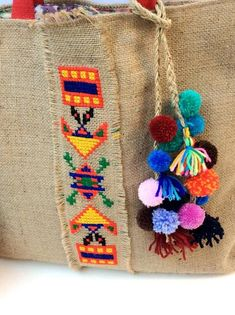 Boho chic jute tote bag, handmade, hand embroidered with colorful tribal pattern and tassel detailing Jute-Einkaufstasche Boho chic handbestickt mit Jute Tote Bags, Burlap Tote, Tote Bags Handmade, Boho Bags, Fabric Bags, Bead Crochet, Hand Embroidery, Creations, Boho Chic