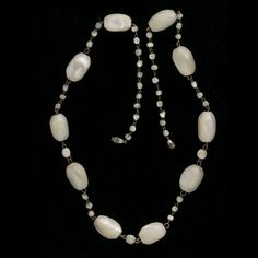 Necklace of gorgeous very old mother of pearl irregular oval beads.  These beads date to the 1920s-30s are hand carved and have a  superb iridescent sheen.  Interspersed with tiny  individually wired mother of pearl beads and silver metal barrel clasp.  24 inches..  beads are approximately 20x14mm.  Necklace weighs 62 grams