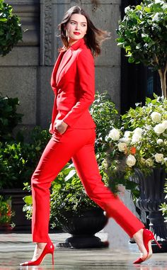 Who else can rock a pant suit that well?! Kendall Jenner looks lovely in red as she models in downtown L.A.