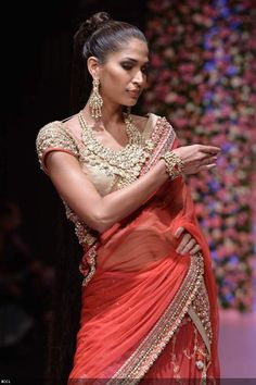 A model walks the ramp to showcase a creation by jewellery designer group PC Jewellers during the International Jewellery Week (IIJW) in Delhi on April 13, 2013