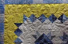 Three beautiful blue, yellow and white quilts with gorgeous Fmq.