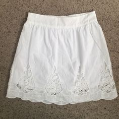 White skirt 100% cotton white skirt with crochet detail at the bottom. Cinched waist and has a small pen mark on the front as pictured LBK Skirts Mini