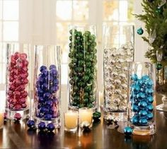 For a simple and unique decoration, fill glass vases with coloured baubles
