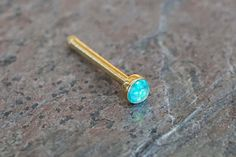 "Gold nose ring. Gold nose stud with a 2mm teal opal gem. 20 gauge nose ring, 1/4"" long post, made of 316L surgical steel plated gold with a tiny synthetic opal stone is discrete yet gives a little fla"