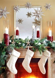 The candle idea is so nice and inexpensive.  I also like the stars hanging down.  Why can't I realize that it's okay to redo the entire mantel for Christmas?  Take down the everyday stuff!