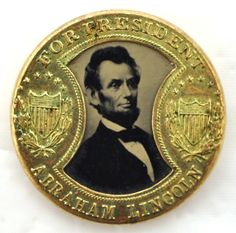 """Exceptional 1864 Lincoln / Johnson Ferrotype Presidential Campaign Token. """"Hourglass"""" format with great Union Shield icons on both sides of ferrotype of Lincoln. Johnson on reverse side."""