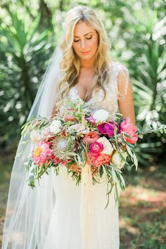 Brittany and Wes // Anna Campbell real bride | Hand-embellished vintage inspired beaded wedding dress with shoulder detail and low back detail | Southern wedding | Bright bridal bouquet | Fitted lace vintage dress | Old Hollywood wedding gown