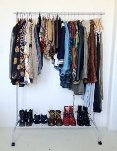 what my closet should look like. minimal except not. has right amount of everything that fits on this rack. no excess.