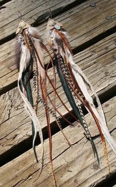 Robin Hood Elf Pixie Forest Sprite Feather & Leather Earrings / festival hippy hippie boho bohemian gypsy nomad tribal. $35.00, via Etsy.