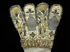 Embroidery detail, early 17th century gloves, kid leather with silk embroidery. KSUM 1983.1.1800ab