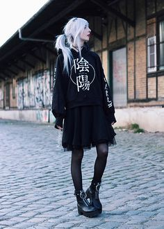 Get this look: http://lb.nu/look/8756867  More looks by Kimi Peri: http://lb.nu/kimiperi  Items in this look:  Kry Clothing Cropped Sweater, Killstar Decay Nu Mourning Dress, Tights, Killstar Up Yours Socks, Disturbia Bovver Boots, Choker   #gothic #grunge #street #girl #kimiperi #blackrush #blogger #model #witch
