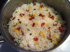 Arroz con maiz, tocineta y cilantro. Long grain rice with corn, bacon and cilantro.