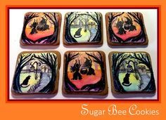 Witch and cat scene cookies painted with edible glitter on the surrounding tree branches.  ***Baked and painted by: Krista Cook from Sugar Bee Cookies***
