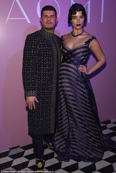 Quirky: Her eyebrows were heavily defined, with a gothic-look of deep plum lipstick but ba...