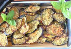 These delicate but Crispy Baked Eggplant Chips are packed with flavor thanks to a light brushing of homemade basil-infused olive oil, and grated Parmesan cheese. #eggplant #eggplantchips #vegetablechips #appetizer #easyappetizer #vegetarianrecipe #parmesancheese #roastedeggplant #vegetablesnacks #plantbasedrecipe #lowcarbsnacks #ketosnacks #kudoskitchenrecipes #cookingwithfreshbasil #infusedoliveoil Eggplant Chips, Baked Eggplant, Vegetable Chips, Vegetable Snacks, Eggplant Sandwich, Brushing, Kitchen Recipes, Plant Based Recipes, Fresh Herbs