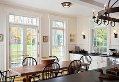 I think that the beautiful furniture and the counter tops and the light fixture were meant to warm up this room, but it didn't. I would want to wear a sweater all the time!