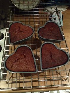 Chocolate sponge hearts cooling ready for covering with chocolate icing and sprinkles #chocolate #sprinkles #cake