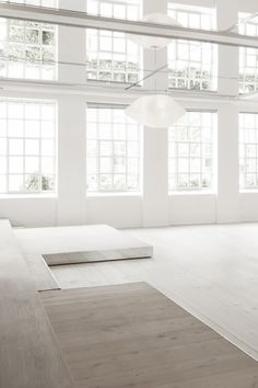 Amazing minimalist space--those windows!