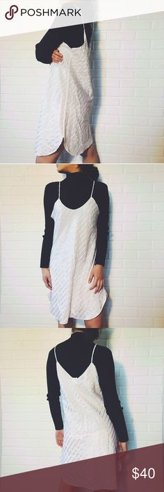 ⬇️ PRICE DROP White Slip Dress ⬇️PRICE DROP White Slip Dress. With shiny accents throughout and a flattering side split curved hem, this slip dress is one for your closet! Pair over a black tee or turtleneck and some ankle booties. Model is an XS/S. Would best fit M! #slipdress vintage! Topshop Dresses