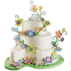 Bridal Path Cake - A floral display lines the path to wedded bliss in this fantastic cake design. Create flowers using the Fondant Cut & Press Set and top with Just Married Cake Pick.