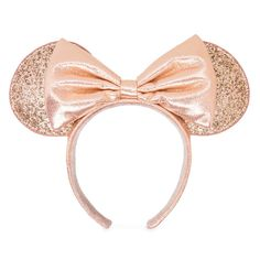 Show off your dazzling style with this glamorous ear headband. Minnie's signature bow is fashioned in soft, metallic Briar Rose Gold fabric to complement the matching headband and glitter-covered ears, creating a coveted fashion accessory to treasure. Disney Ears Hat, Mickey Mouse Ears Headband, Minnie Bow, Mickey Ears, Horn Headband, Ear Headbands, Rose Gold Fabric, Briar Rose, Ear Hats