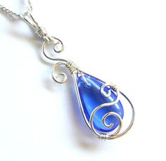 Graceful and elegant pendant necklace is handcrafted with a beautiful royal blue glass briolette and sterling silver-filled* wire. Pendant comes