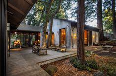 This outdoor space and its location, seemingly in the middle of the woods, is so very appealing.