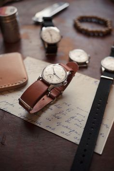 papers, leather, watches