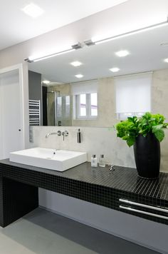 OOOOX | NAD VODOVODEM - bathroom with black mosaic desk and grey cement walls