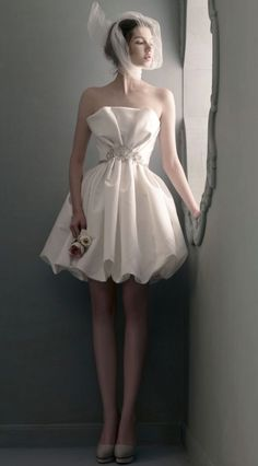 Classy strapless white wedding dress with accented waistline; Featured Dress: St. Pucchi