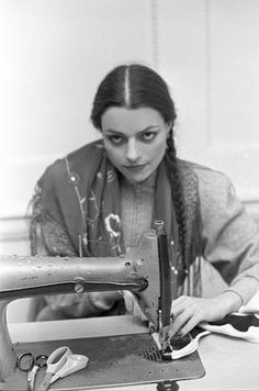 """Norma Kamali at work. known for the """"sleeping bag"""" coat, garments made from silk parachutes."""