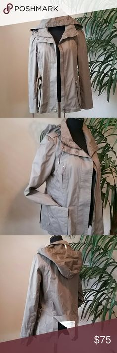 "ZARA Khaki Trench Coat EUC! ZARA Khaki Trench Coat only worn once! Excellent condition. I removed the belt and can't find it. So many great details to list on this beauty! Removable hood, lots of snaps, zips and pockets! 70% polyester/30% polyester.  Layflat measurements  Length 25"" Sleeves 25"" Chest 20"" Jackets & Coats Trench Coats"