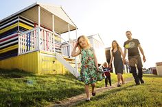 Creative family and children's photography in Kent and London, UK. Family photo shoot amongst the beach huts in Whitstable. Schryver Photo www.schryverphoto.com