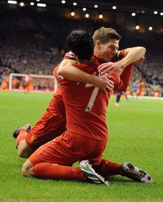 Gerrard cannot suppress his delight at Suarez's first goal, achieved with dogged determination
