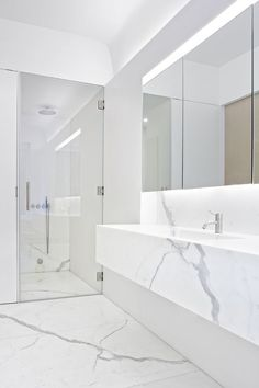 White Calacatta marble bathroom interior. Templer Townhouse — Workshop for Architecture:
