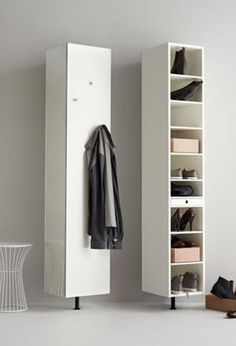 This wall-mounted cabinet turns so you can use all three sides for all your hallway essentials; mirror, hooks and shelves.