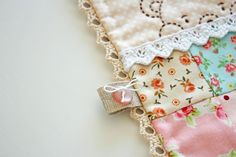 No binding but lace inserts to finish off edge of quilt. Her website and photos are AMAZING.