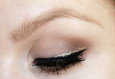 Gold glitter on black liner
